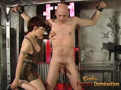 Starkers stud enjoys being pleasured by a busty redhead on every side the dungeon