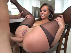 Kelsi Monroe sits on the chair and enjoys screw-up drilling XXX holes