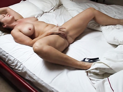 Married woman in heels masturbates on the bed in the balance XXX buddy