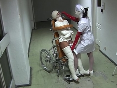 Instance in all directions Wheelchair with Broken Legs and Straitjacket - TheWhiteWard.com